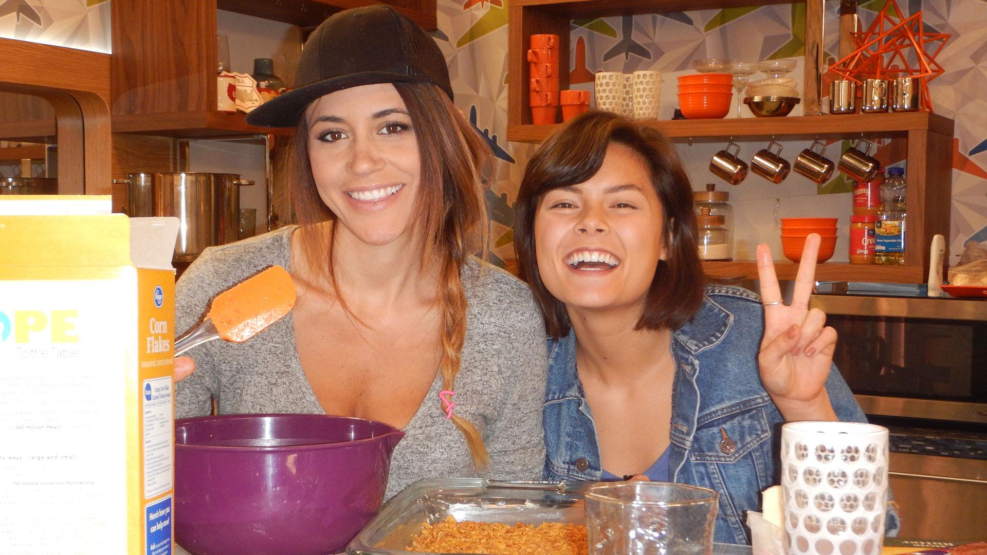 Tiffany and Bridgette make a snack in the kitchen.