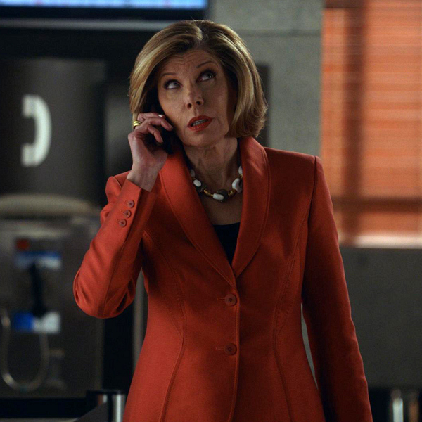 Diane wears an orange Carolina Herrara jacket.