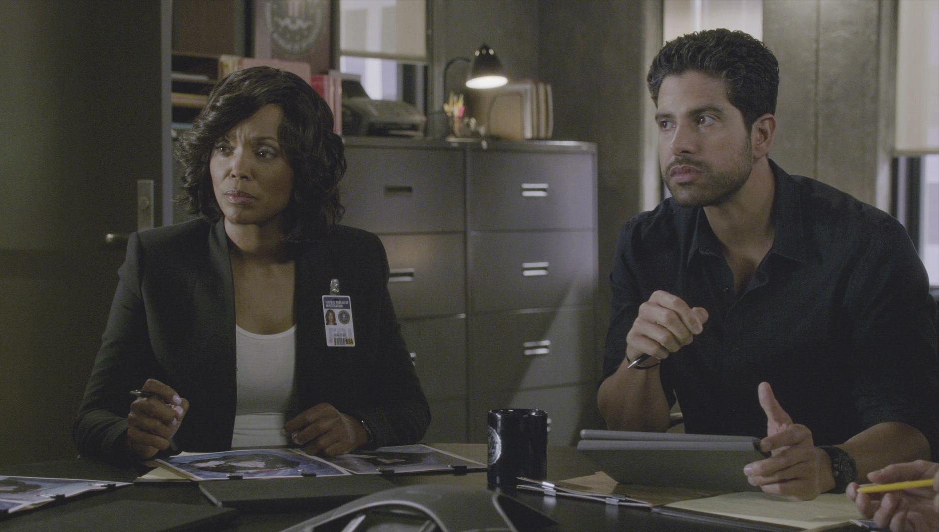 Dr. Lewis and Agent Alvez discuss the case.