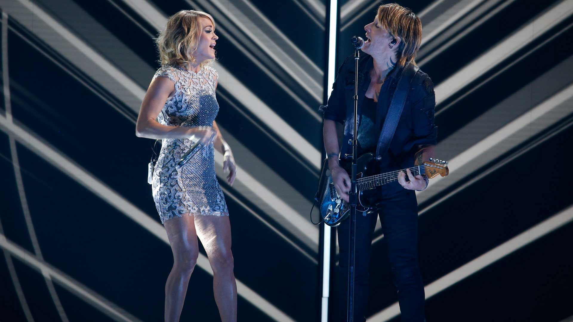 """Carrie Underwood and Keith Urban perform """"The Fighter"""" at the 2017 GRAMMY Awards."""