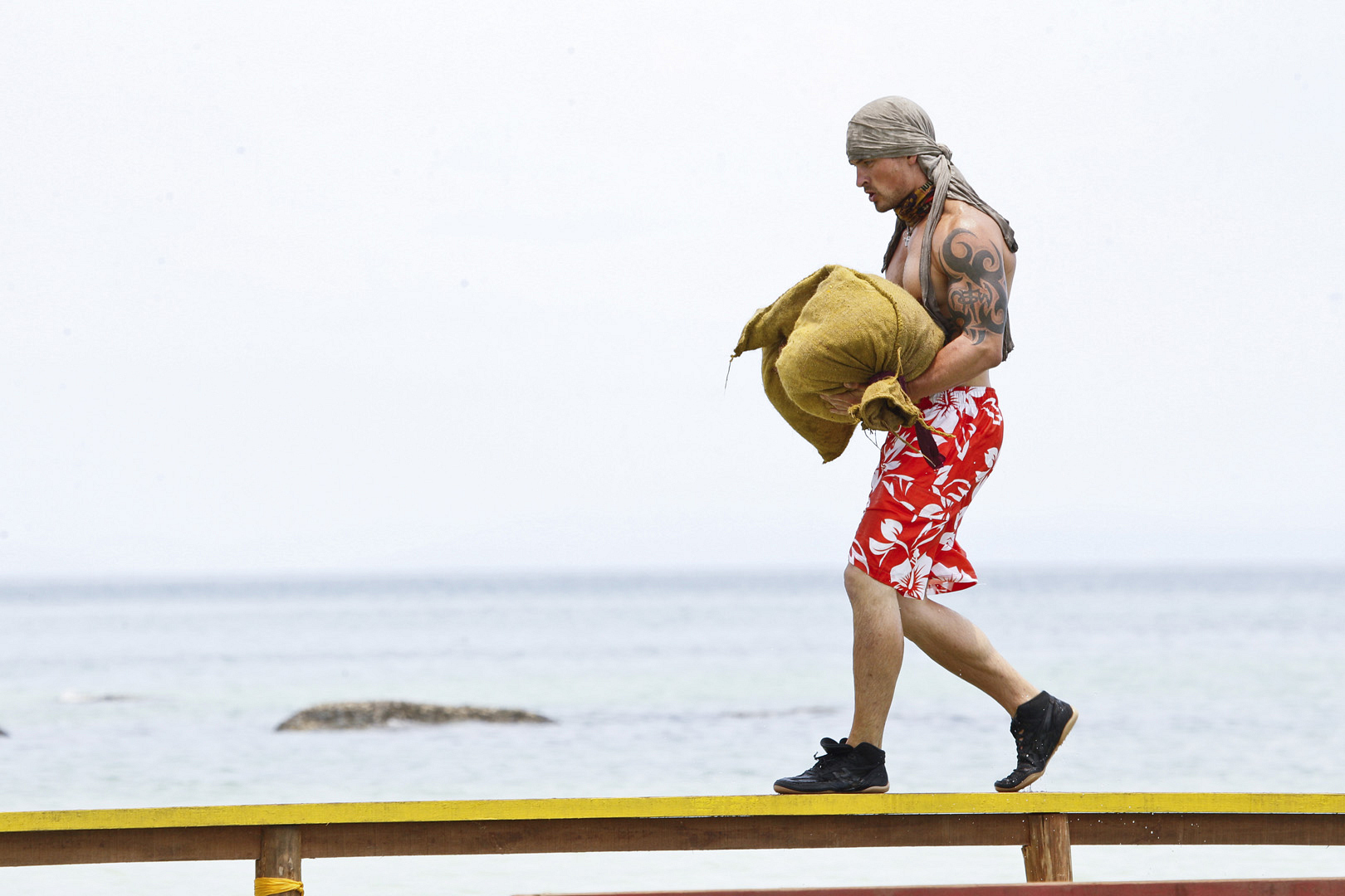 In this challenge, Caleb carries a heavy load of rice like a pro.