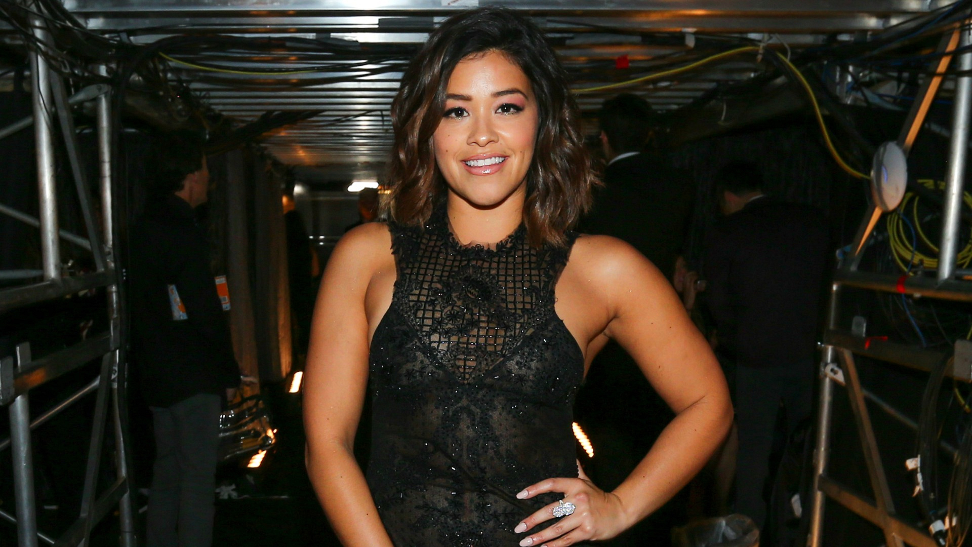 Actress Gina Rodriguez werks it in a black lace dress before introducing a performance from Maren Morris and Alicia Keys.