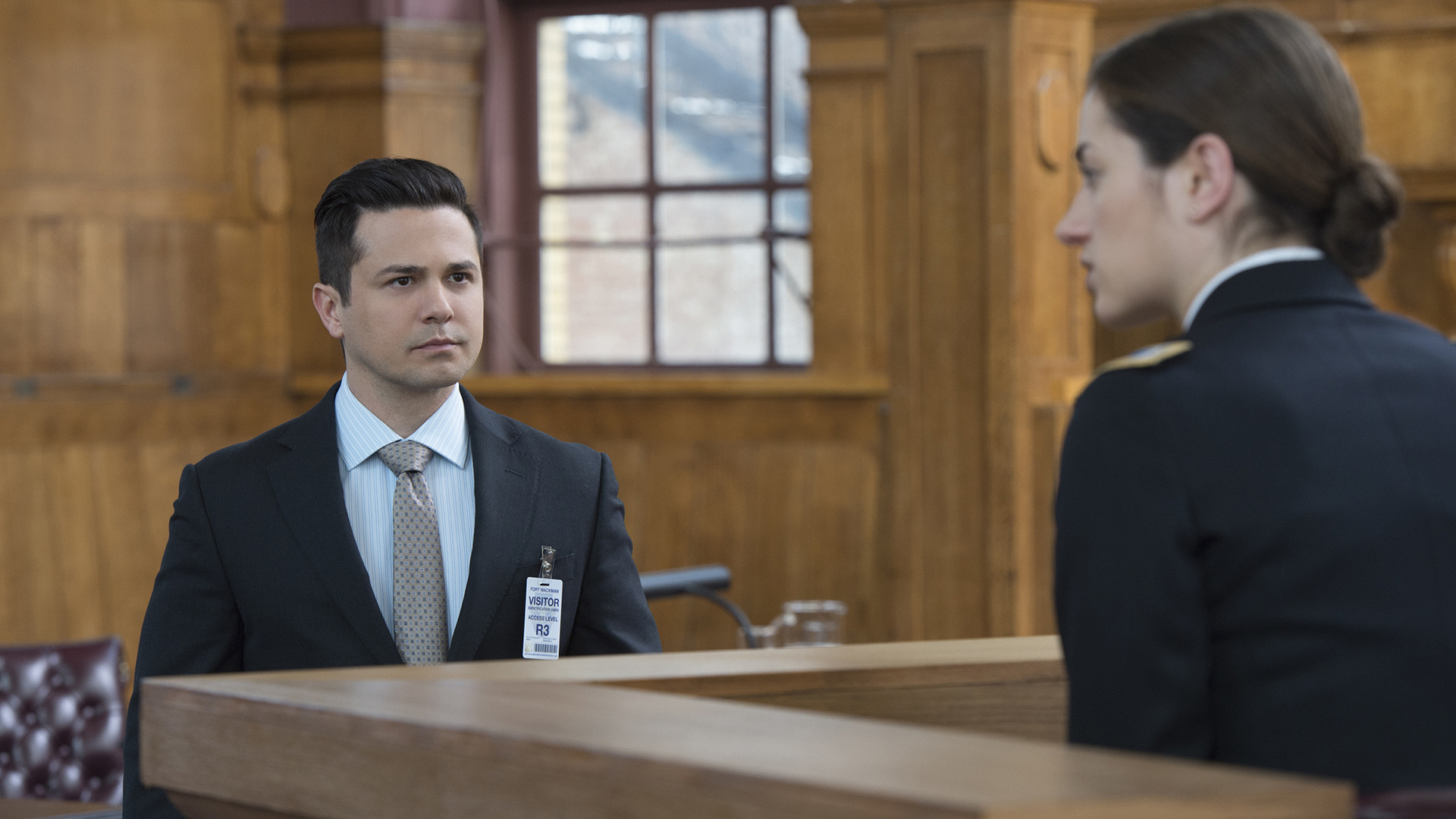 Benny questions his army analyst client on the stand.