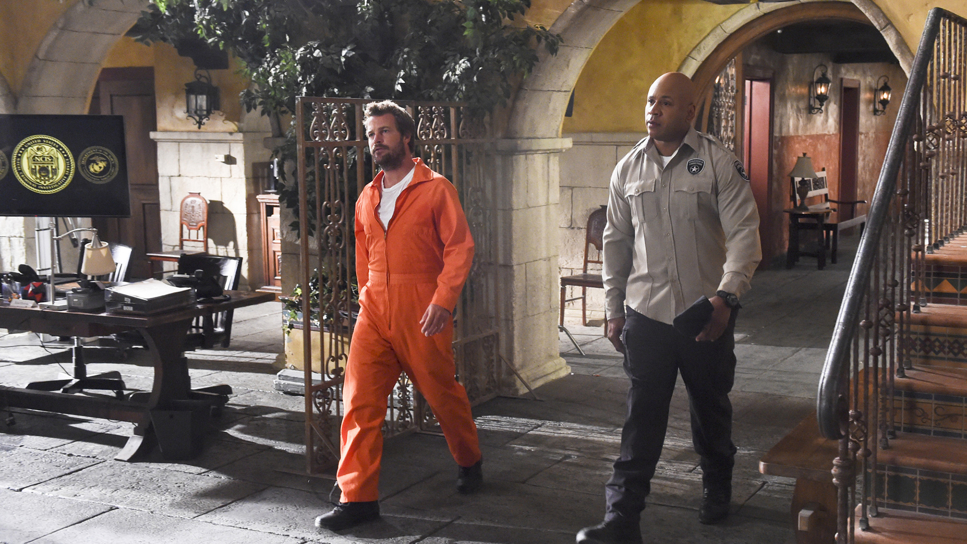 He can even make a prison jumpsuit look good.