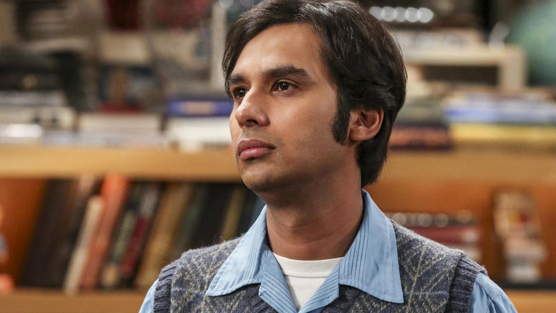 Raj looks on, stoically.