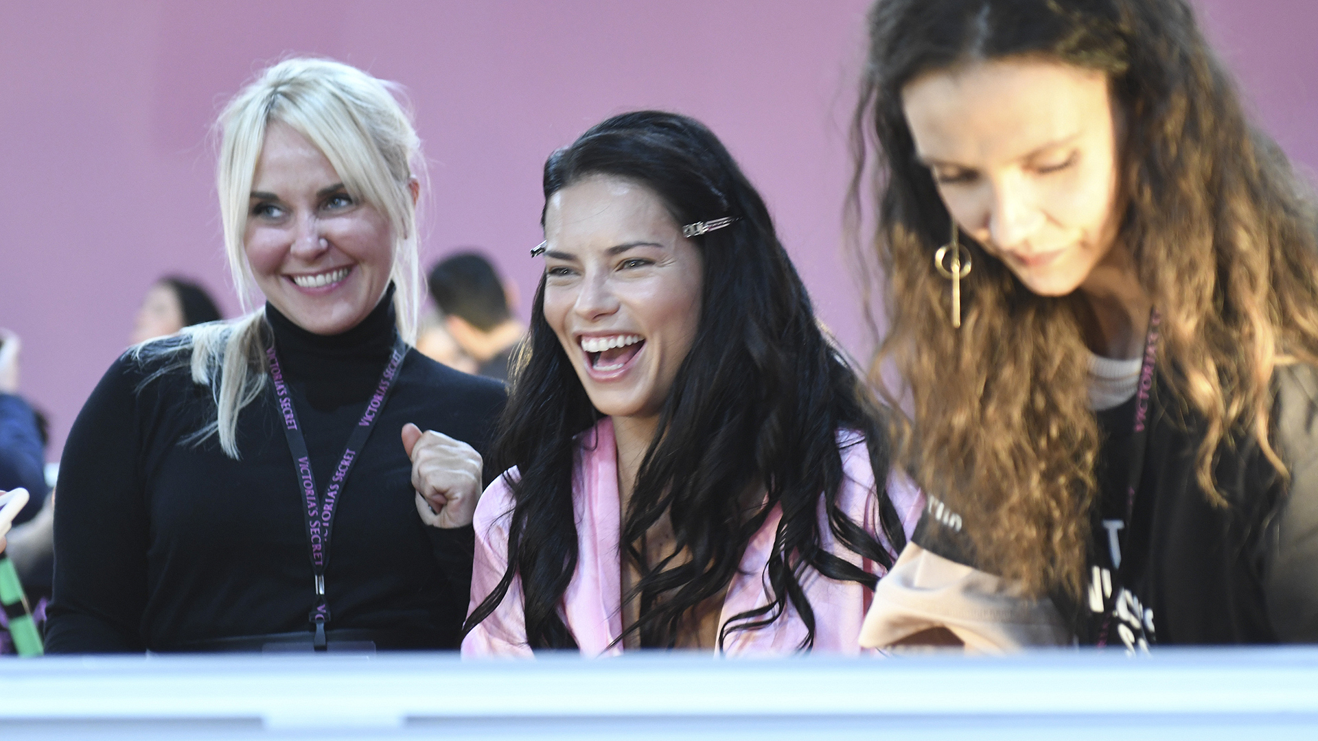 Angel Adriana Lima jokes with the hair and makeup artists.