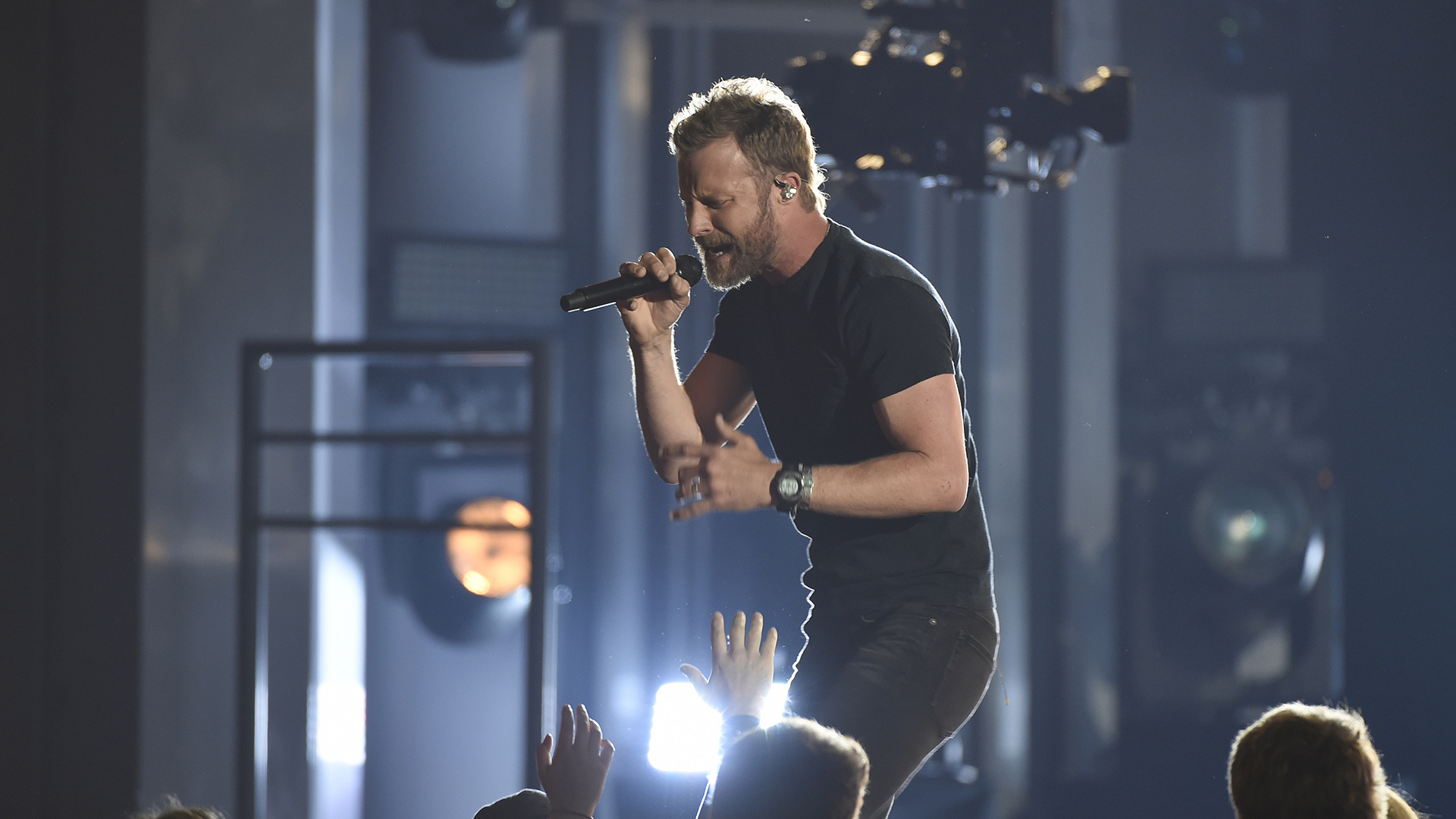 "Dierks Bentley comes on stage for a rendition of ""Woman, Amen."""