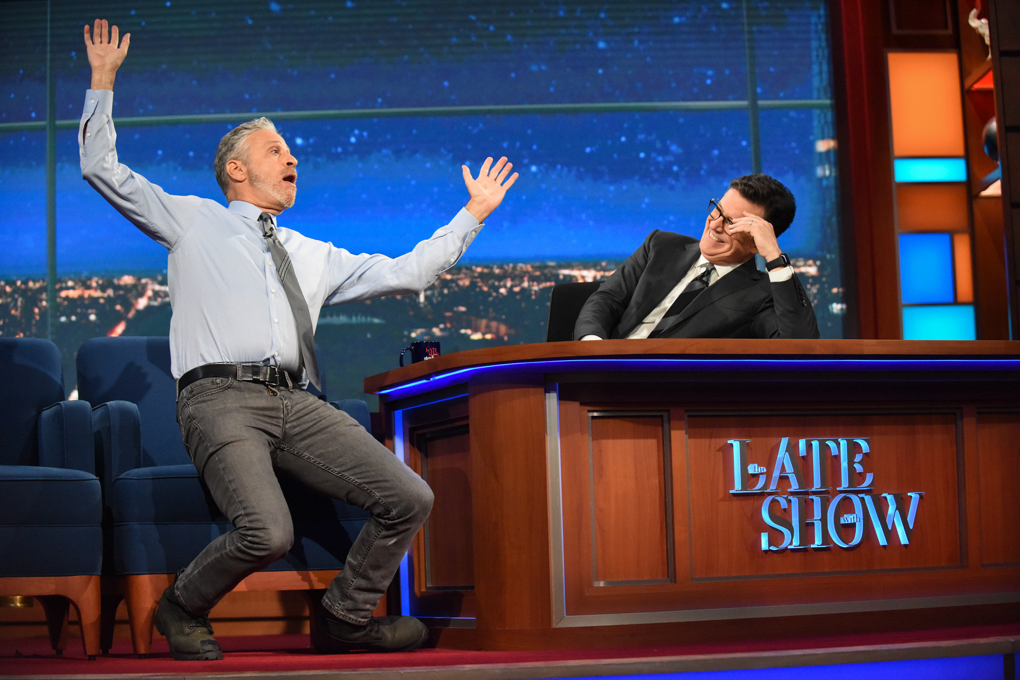 Jon Stewart struggles to get comfortable on the other side of the desk.