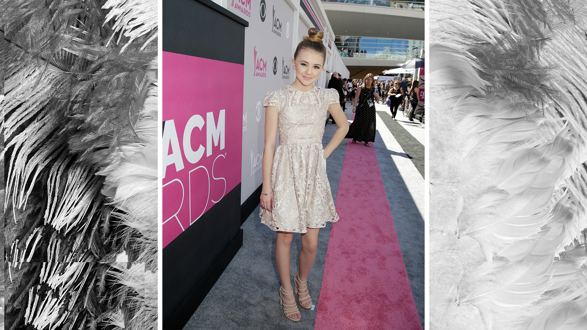 Tegan Marie is adorable in a top knot and frilly lace knee-length dress.