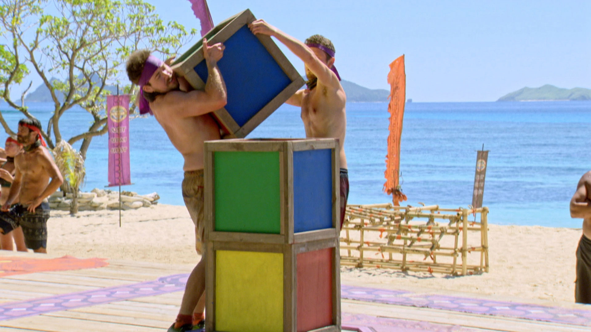 Zeke and Adam work hand-in-hand to place their third block on top.