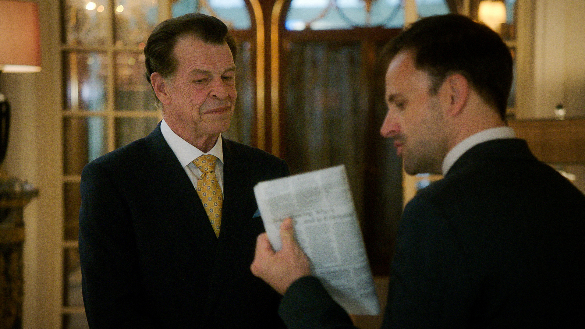 John Noble as Morland Holmes and Jonny Lee Miller as Sherlock Holmes