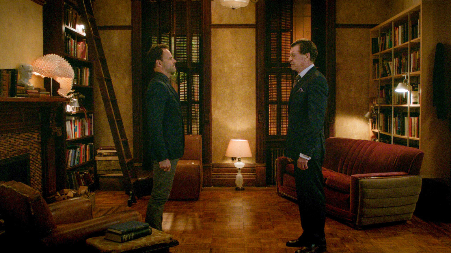 Jonny Lee Miller as Sherlock Holmes and John Noble as Morland Holmes