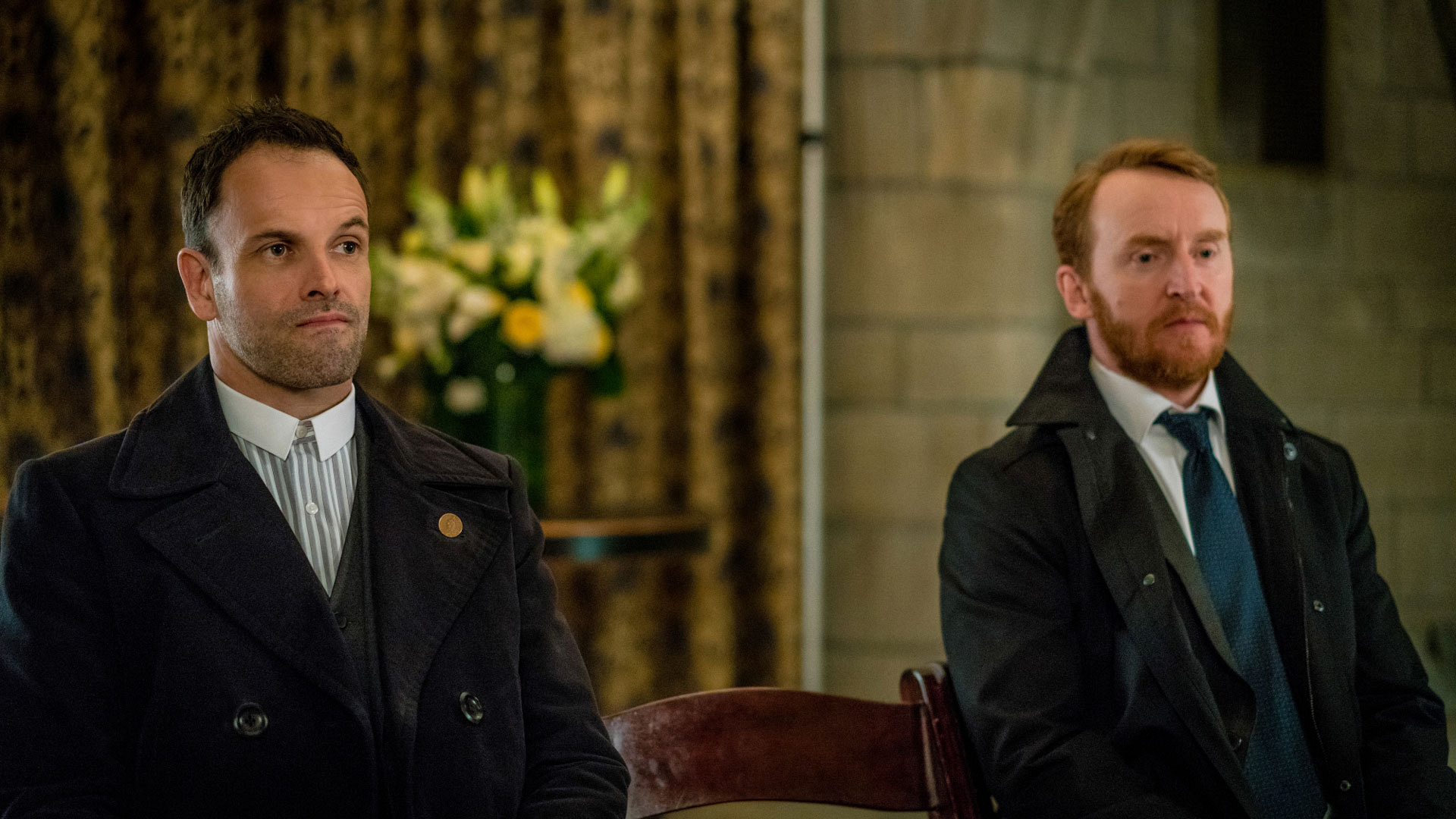 Sherlock Holmes sits next to Joshua Vikner.
