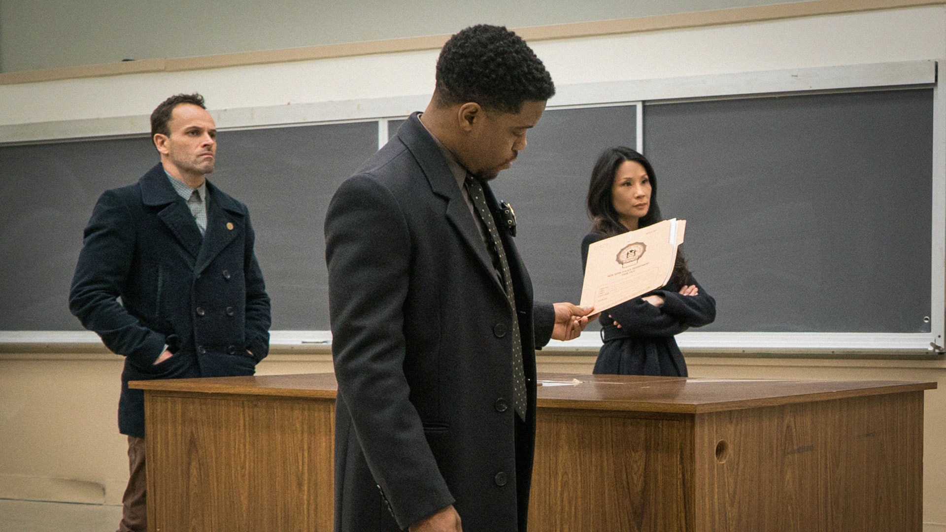 Jonny Lee Miller as Sherlock Holmes, Jon Michael Hill as Detective Marcus Bell, and Lucy Liu as Dr. Joan Watson