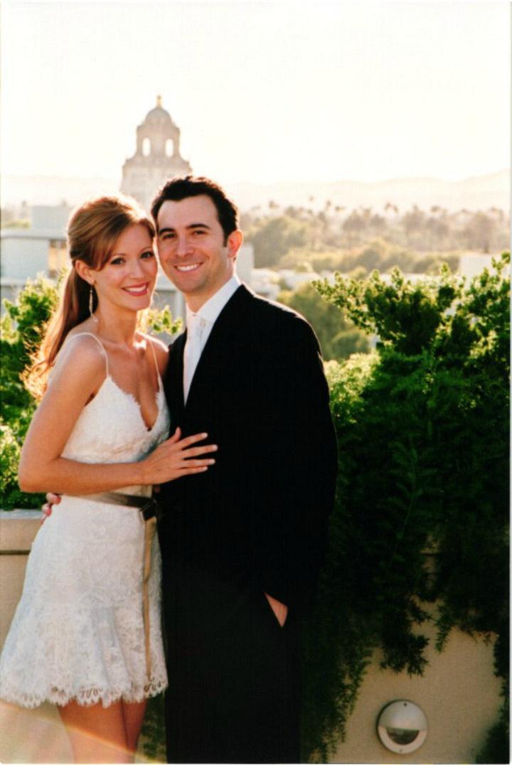 Elizabeth Bogush is radiant in a white mini dress.