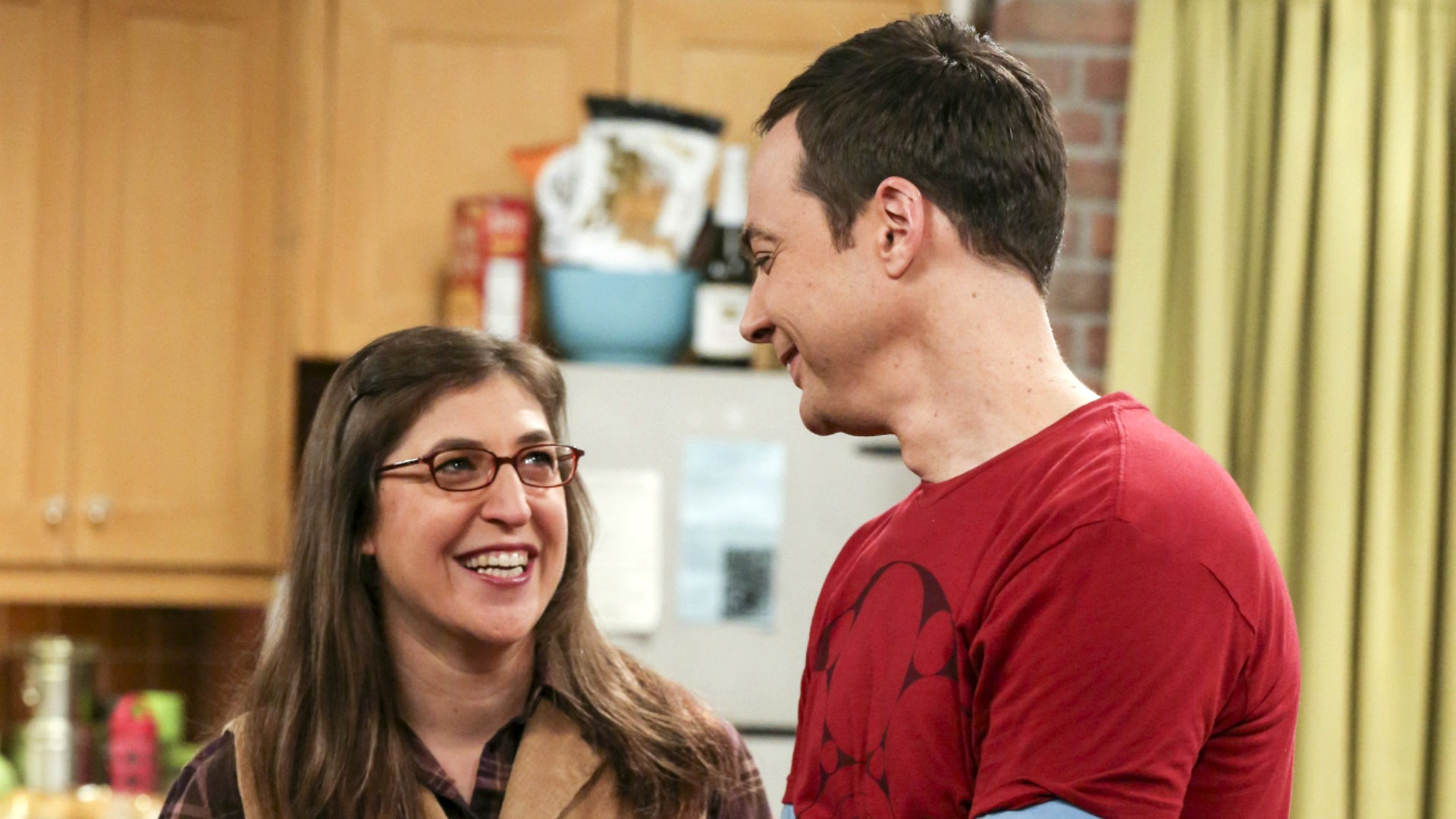 Sheldon and Amy smile as their living situation becomes more permanent.