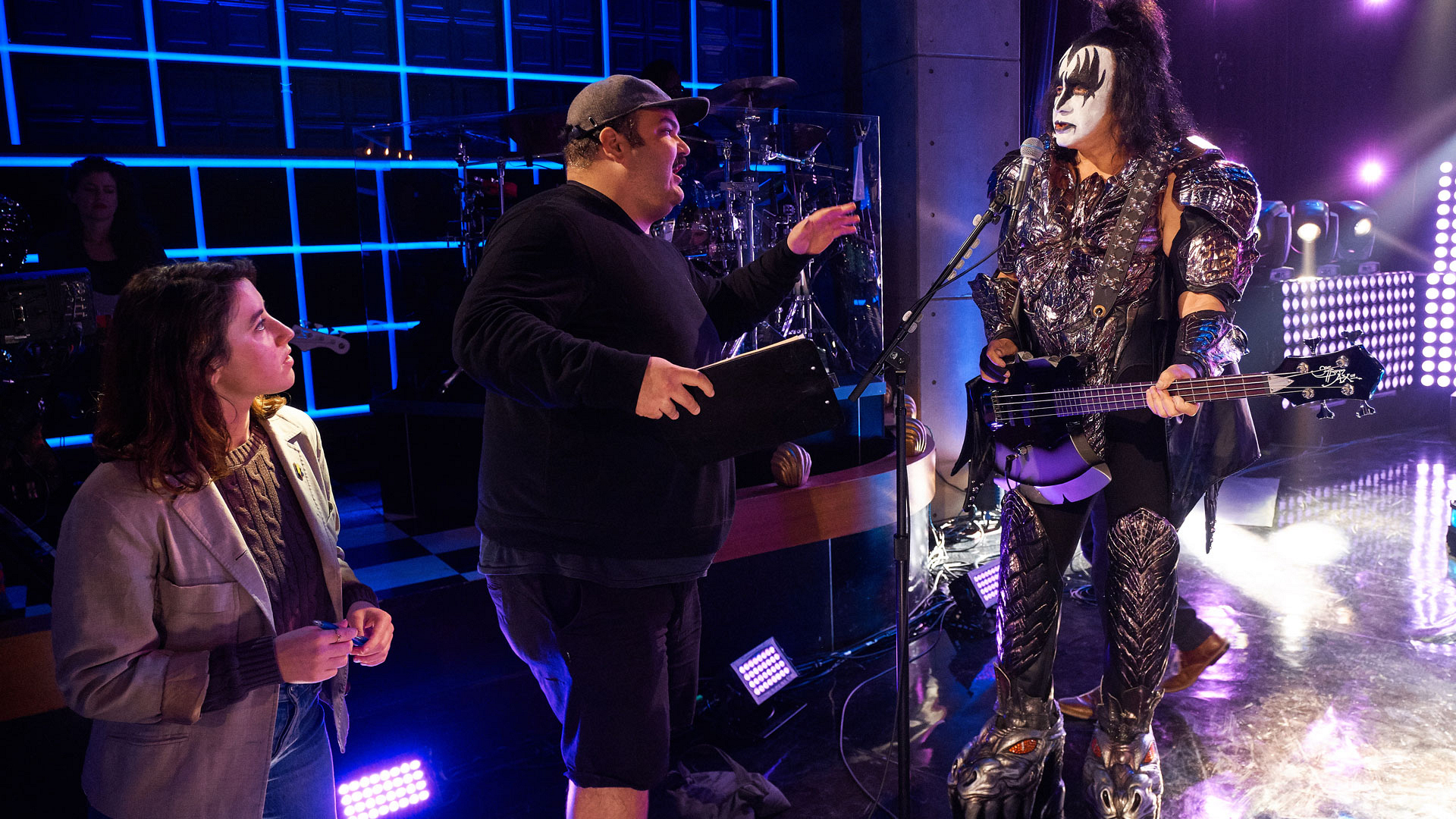 Writer Ian Karmel and Comedy Segment Producer Rosie Kaller prep Gene Simmons