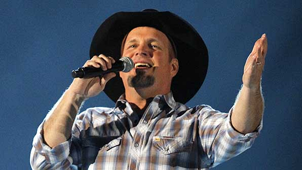 Garth Brooks is nominated for Entertainer of the Year, and currently holds the most number of wins in this category.