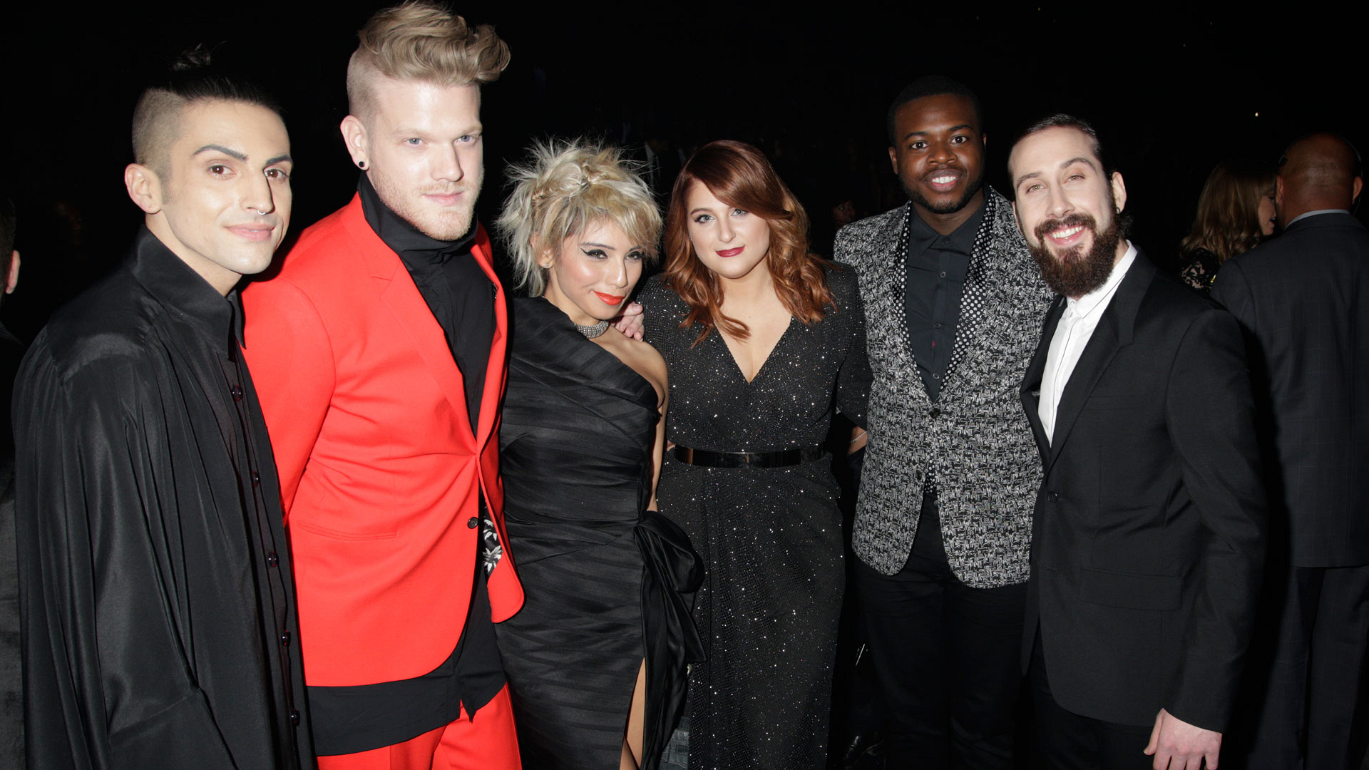 The members of Pentatonix flank either side of Meghan Trainor
