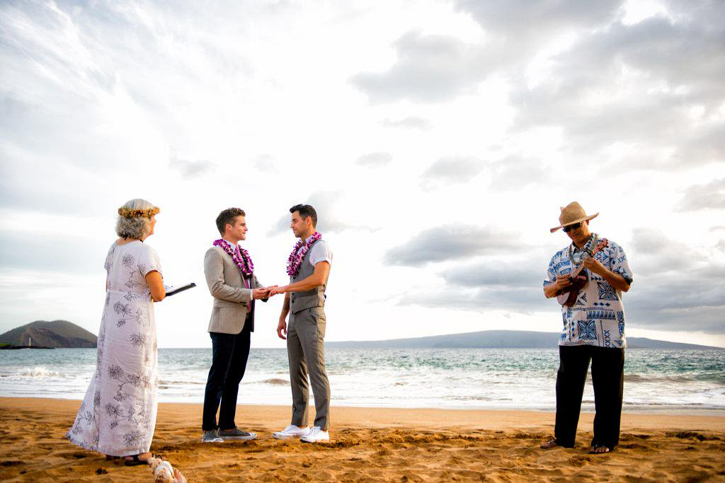 "Greg Rikaart happily says ""I do"" on the beach in Maui."