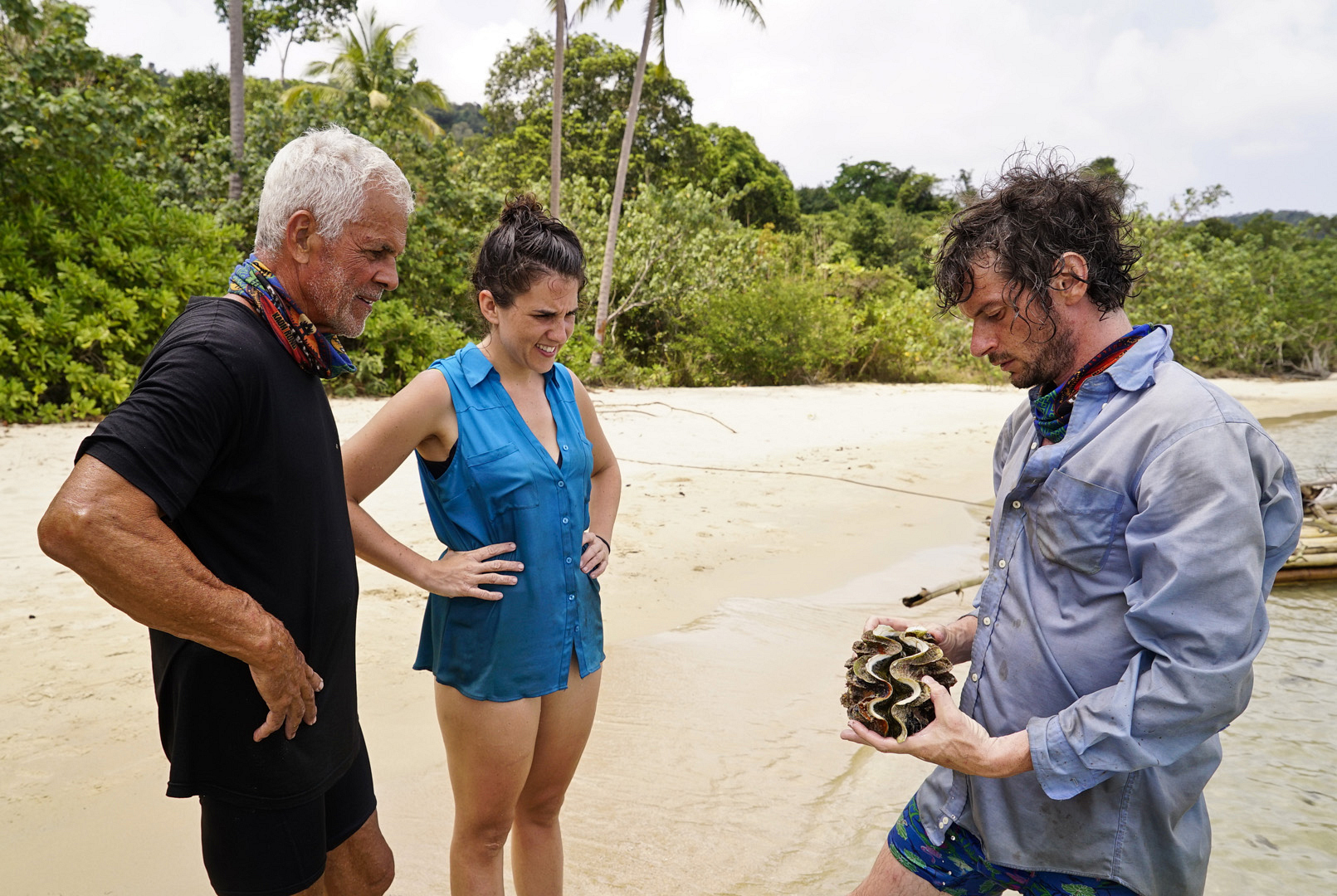 Joe, Aubry, and Neal congregate around a clam.