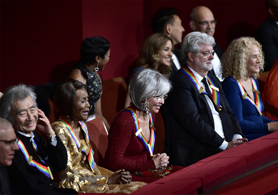 The five honorees graciously bow from their balcony seats.