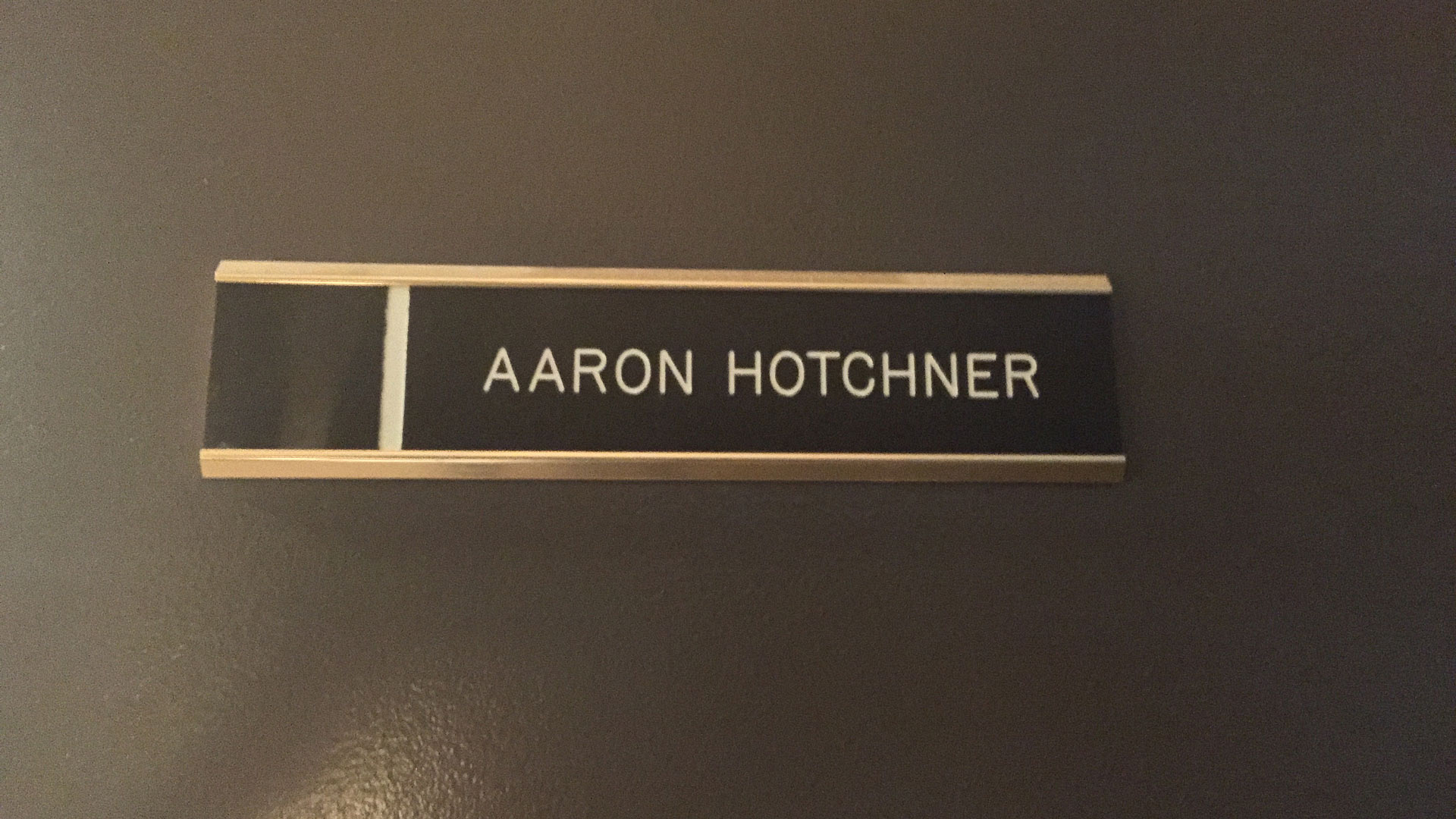 A closeup of SSA Aaron Hotchner's office door