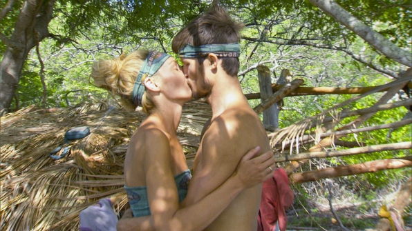 Survivor castaways show us what love's all about with this hug (and kiss).