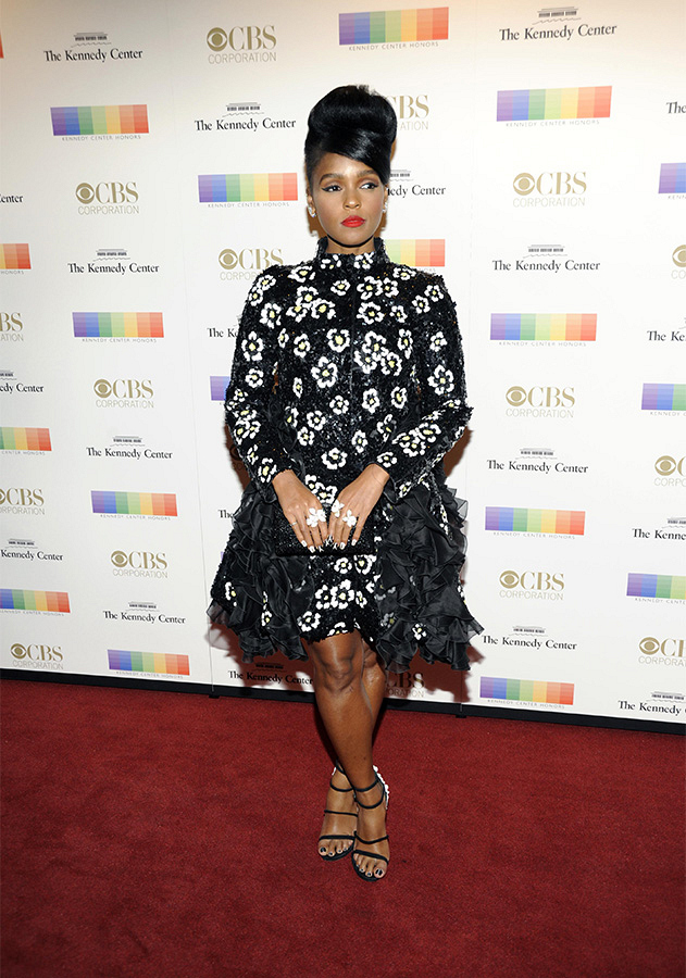 Musician Janelle Monáe poses in a black-and-white beaded floral dress.