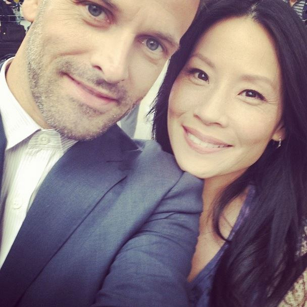 Jonny Lee Miller and Lucy Liu on set.