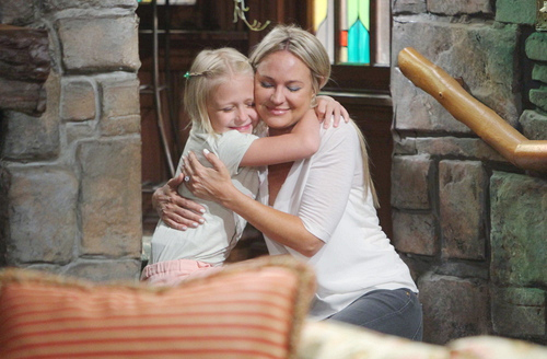 Sharon embraces her daughter