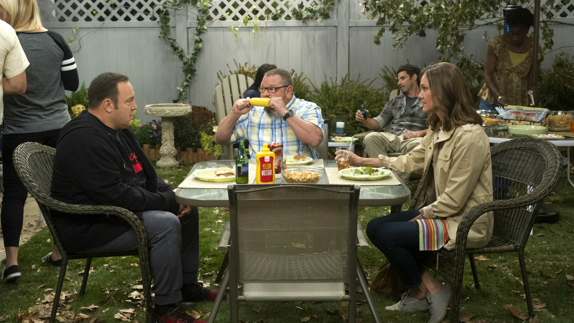 Kevin and Donna attend a barbecue.