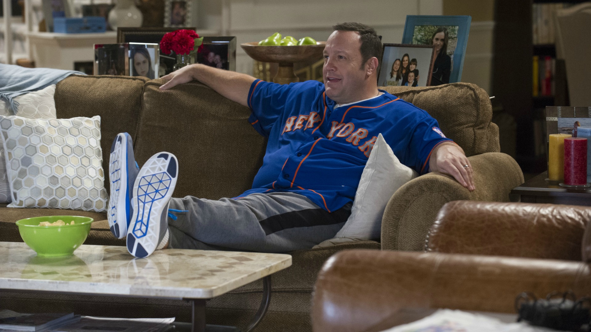 Kevin kicks his feet up as he watches the baseball game.