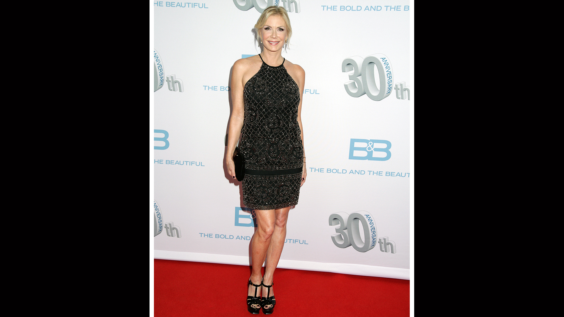 Katherine Kelly Lang is radiant in a sparkly black cocktail dress.