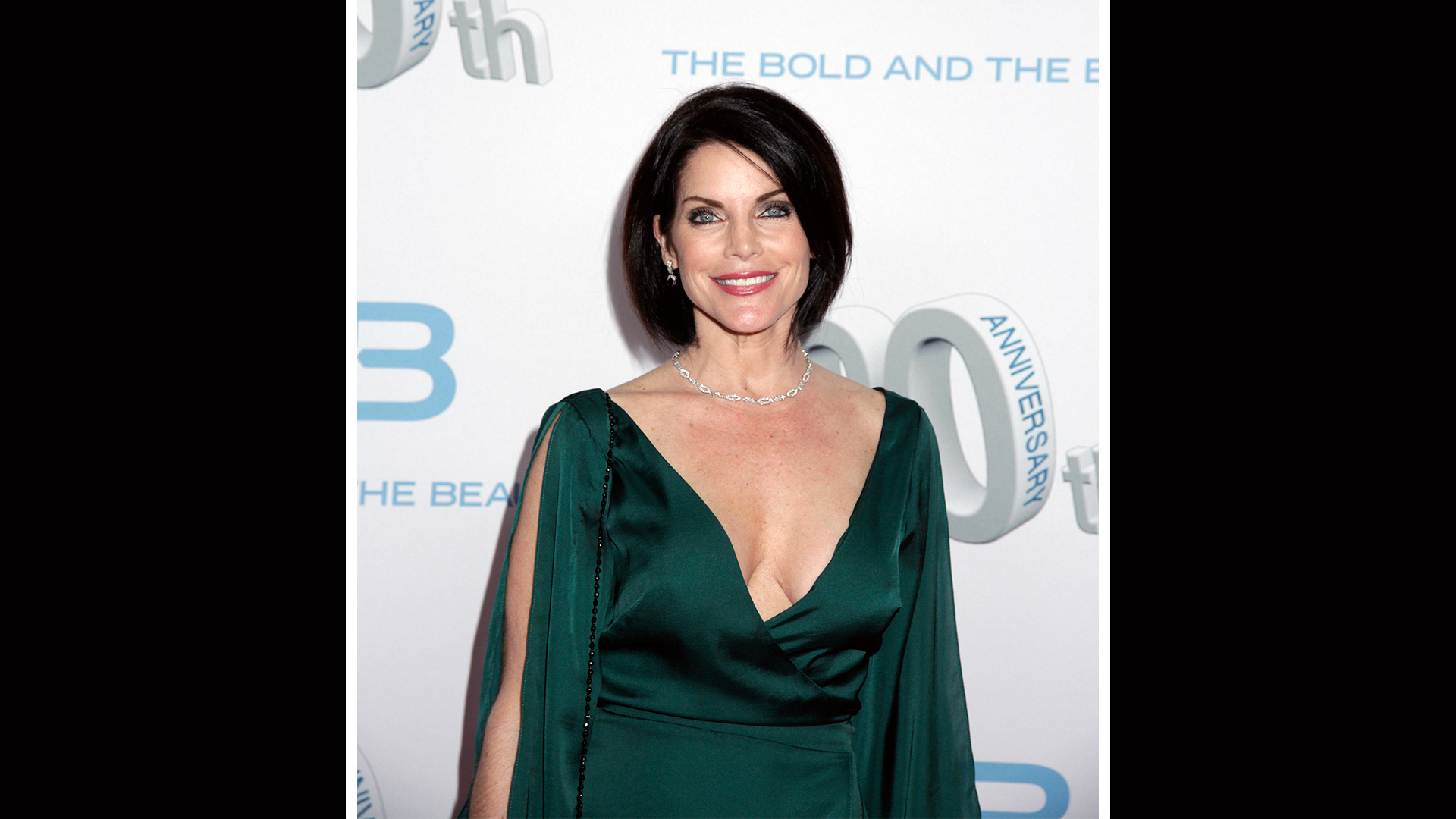 Lesli Kay's emerald-green dress brings out her striking eyes.