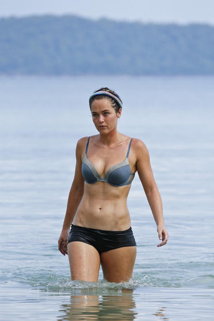 Liz takes a break and walks in the ocean by herself.