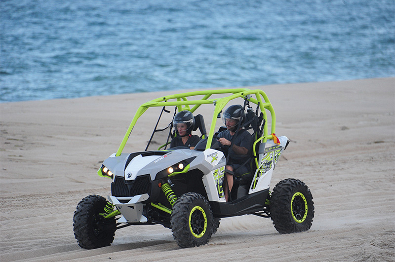 Logan (left) and Chris (right) ride a dune buggy to the final challenge.