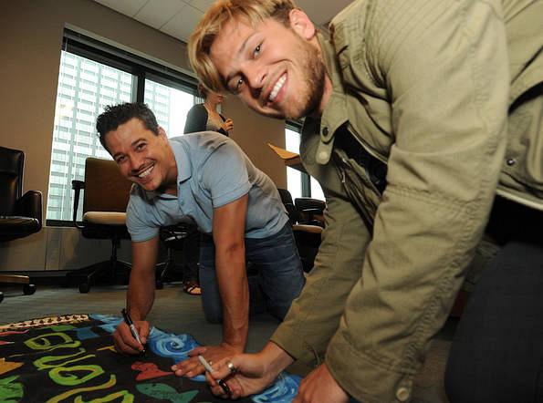 Rob and Matt Sign the Murlonio Flag Before Finale