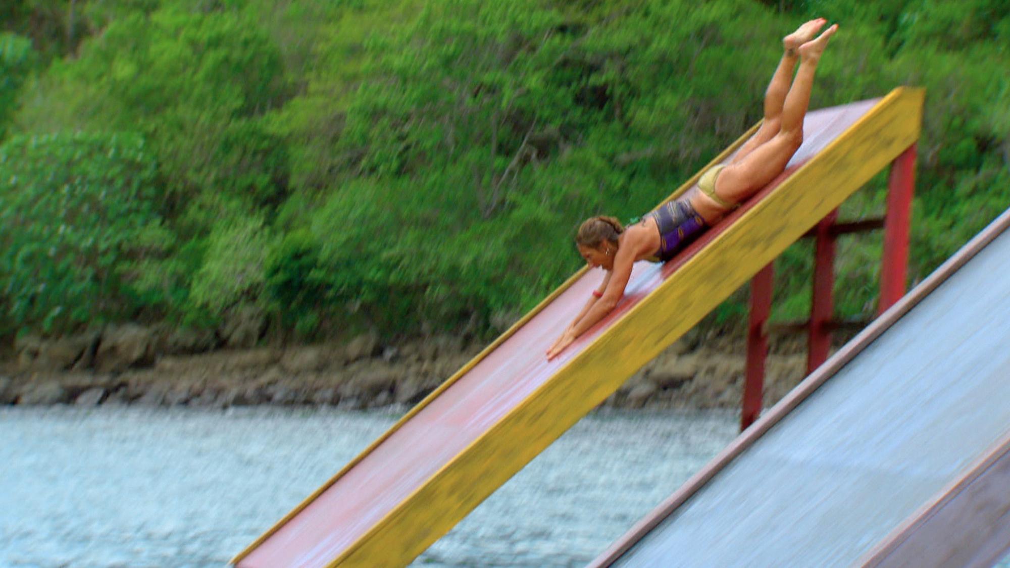 Carolyn slips down the ramp
