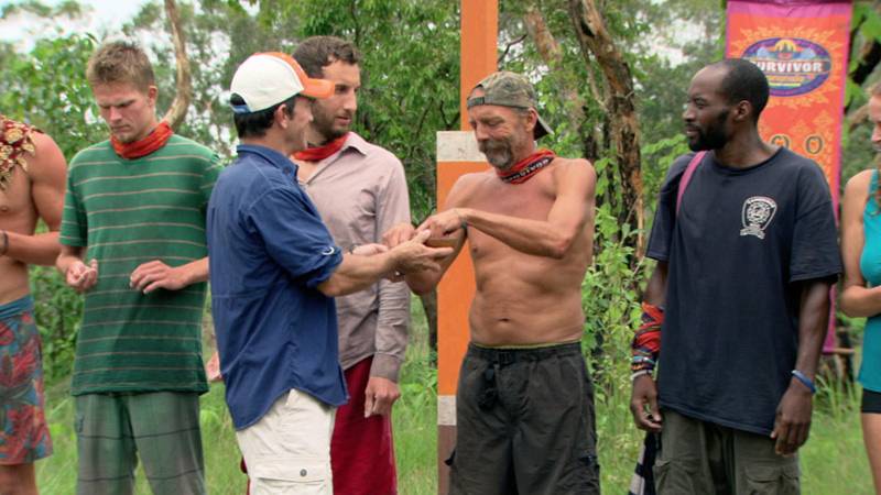 Jeff presents Keith with black-and-white rocks before telling the castaways what's ahead.