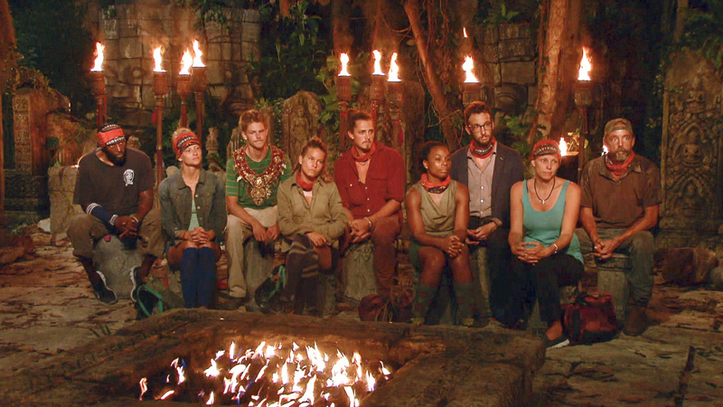 The castaways listen in before the voting occurs at a tense Tribal.