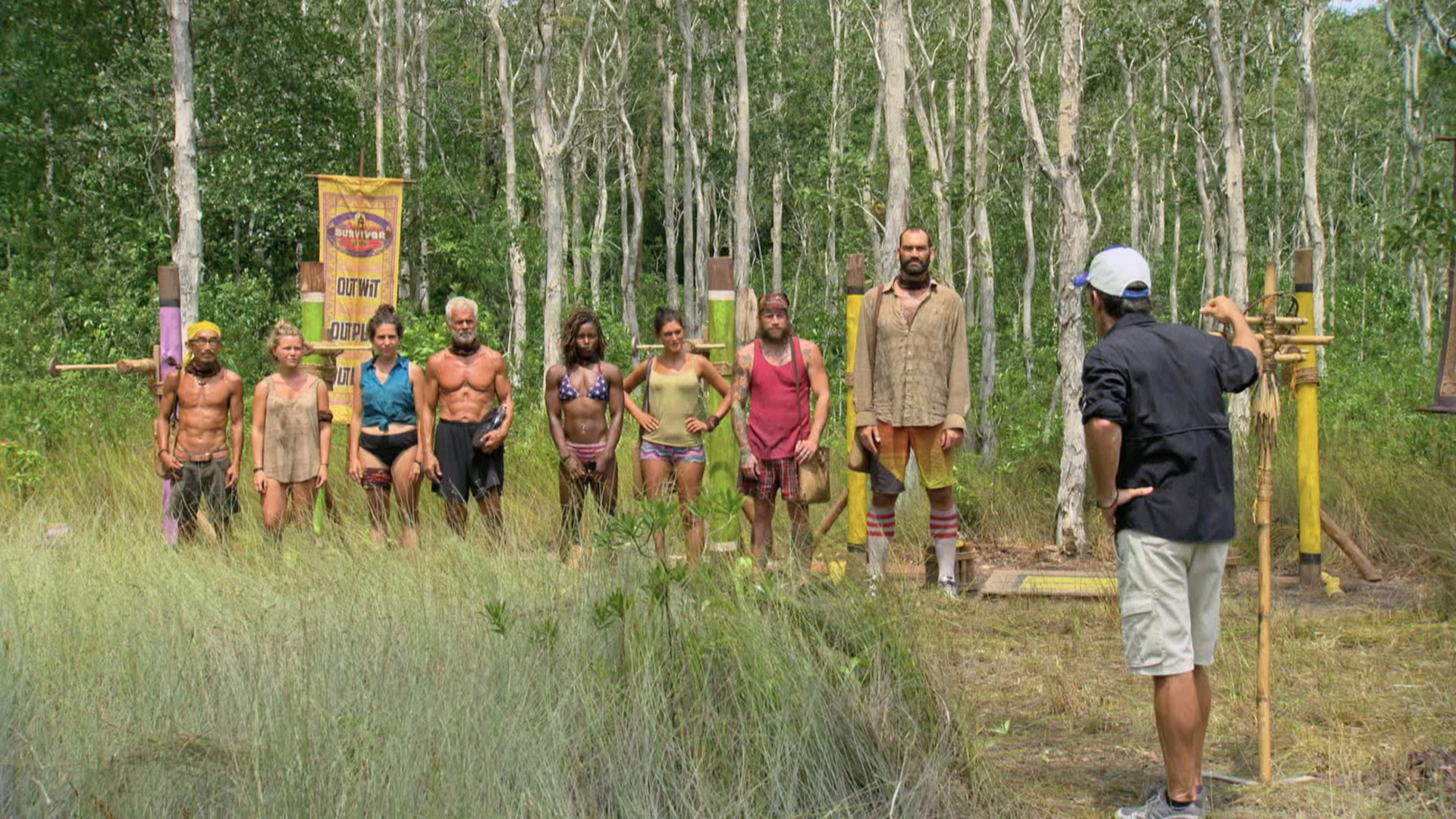 The remaining castaways listen to instructions for the next Individual Immunity Challenge.