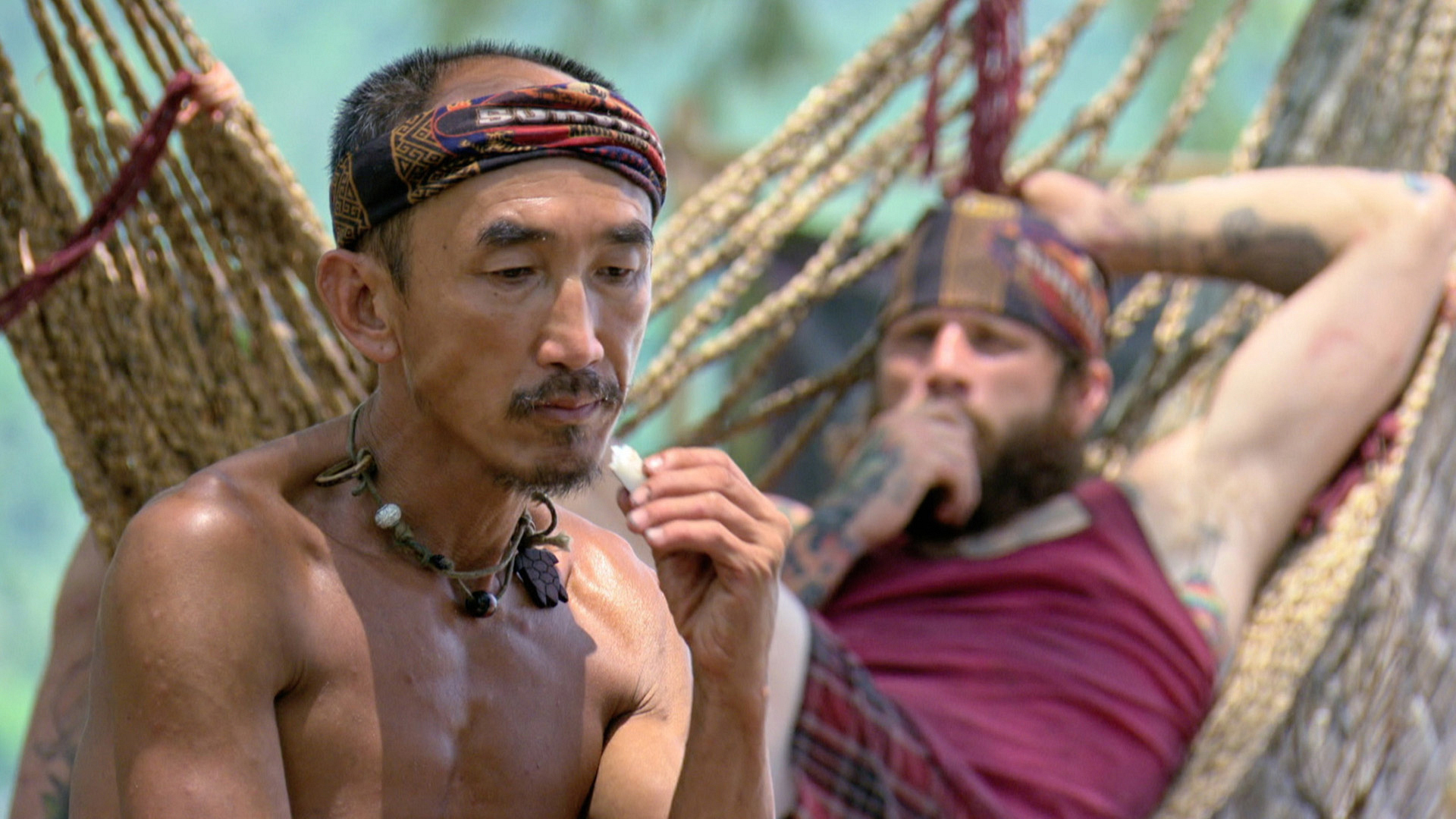 Tai and Jason hang out at camp between challenges.