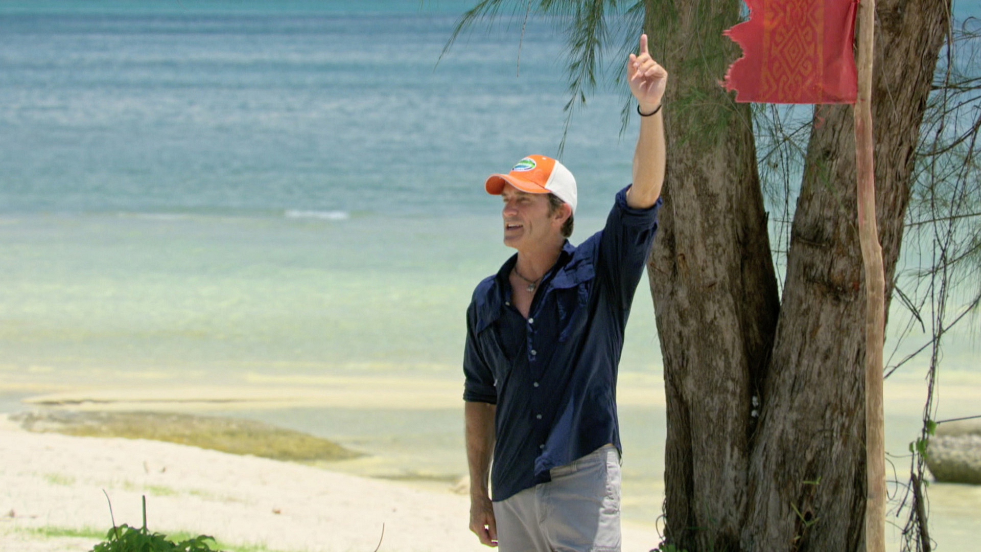 Host Jeff Probst raises his hand so the Final 4 can get on their marks.