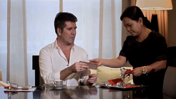 Simon Cowell tears through wrappers