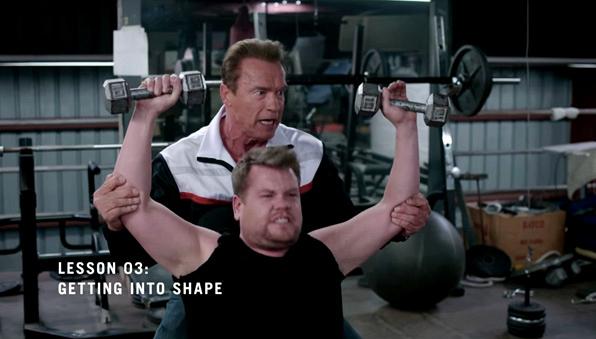 Arnold Schwarzenegger pumps James up