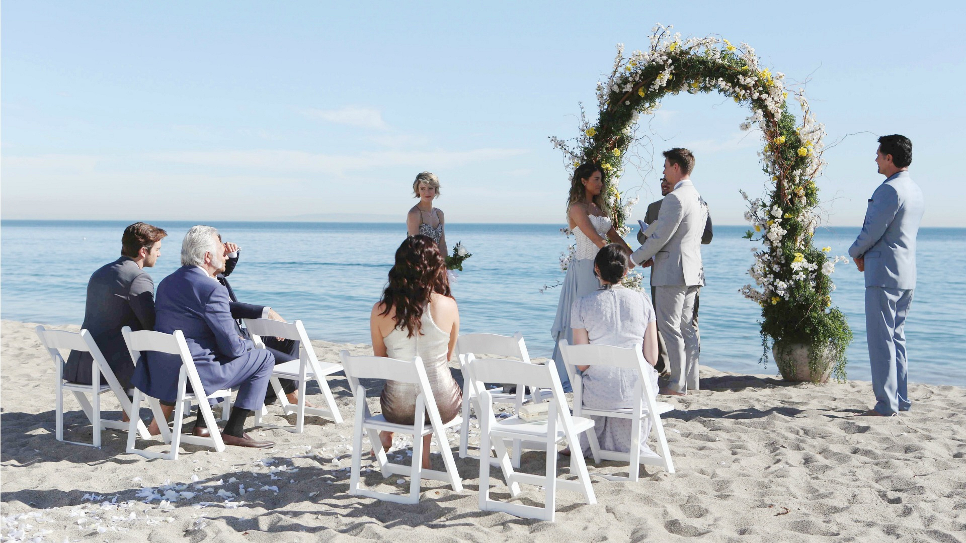 Everyone watches as the couple exchanges vows.