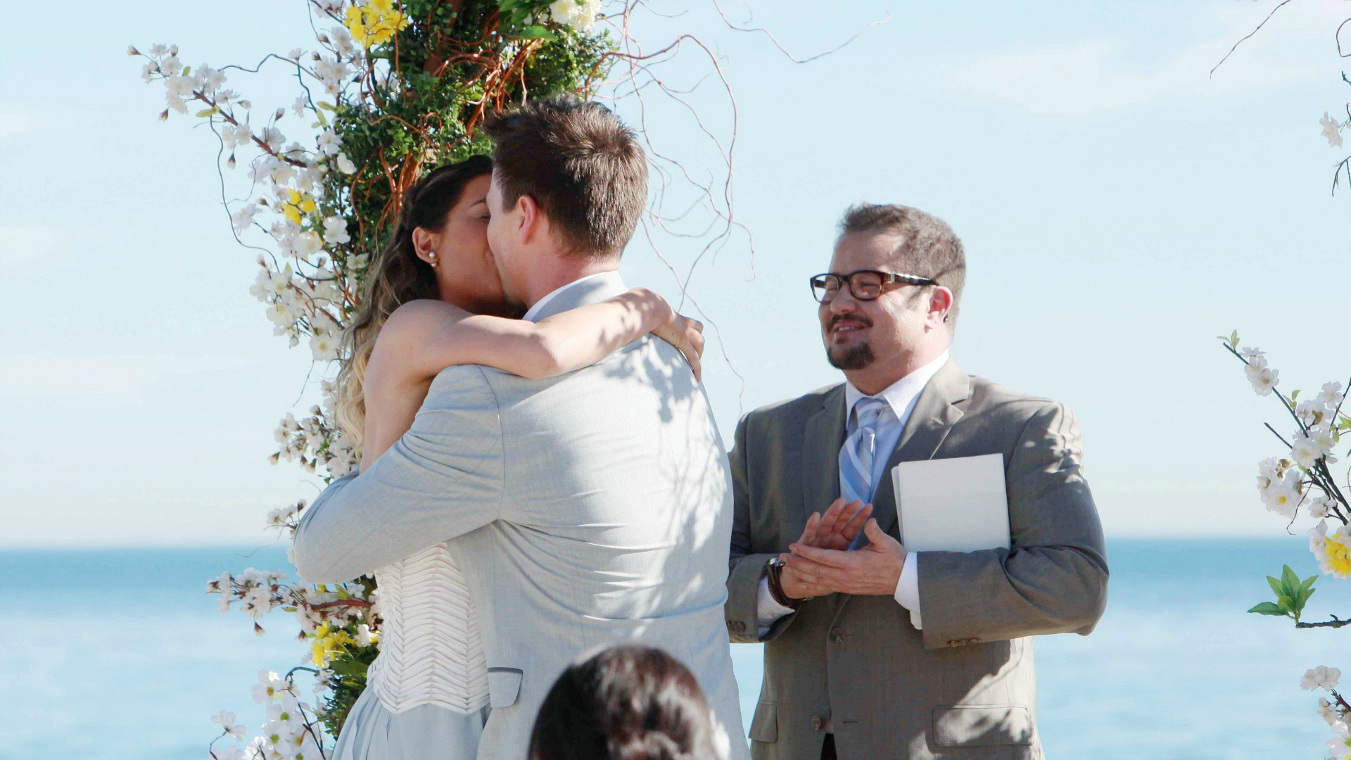 The couple seals their vows with a kiss.
