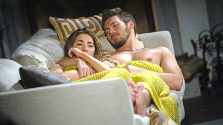 Steffy and Liam cozy up on the couch.