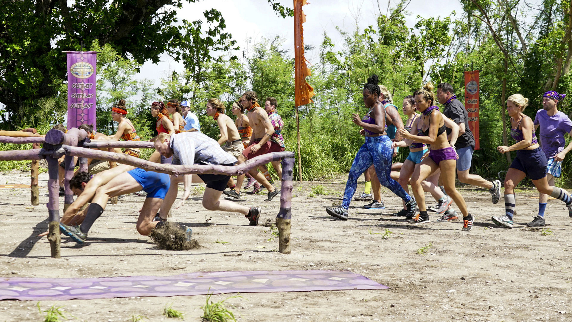 Both tribes bolt at the sound of Jeff's voice as they fight for this season's first Immunity Idol.